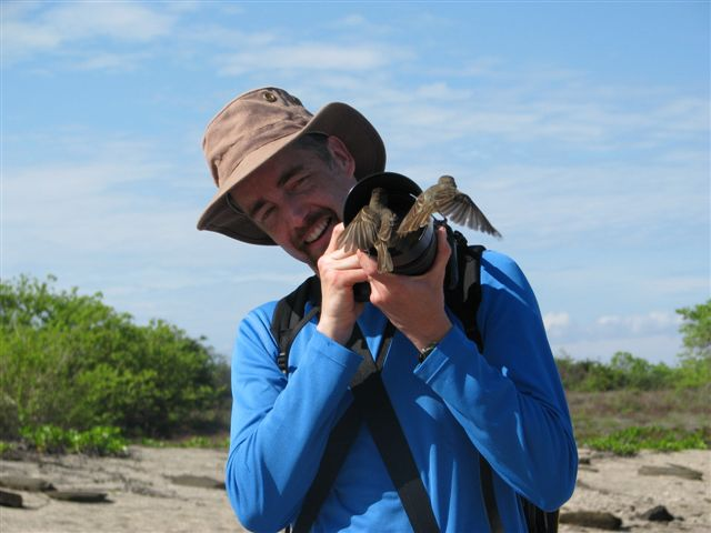 Chris Earley with Galapagos flycatchers, photo by Tom Chatterton