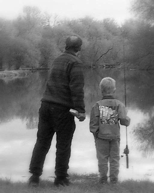 Man and boy fishing by the Eramosa River