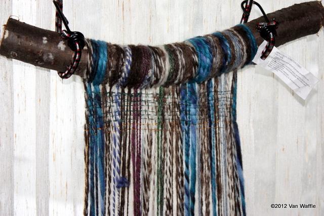 Weighted warp loom