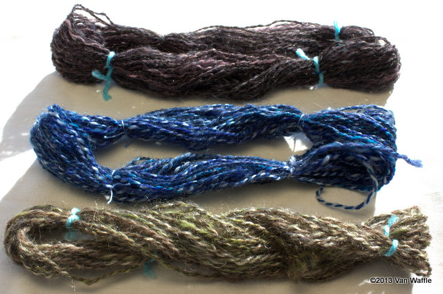 Three yarns samples spun from roving made with a hackle